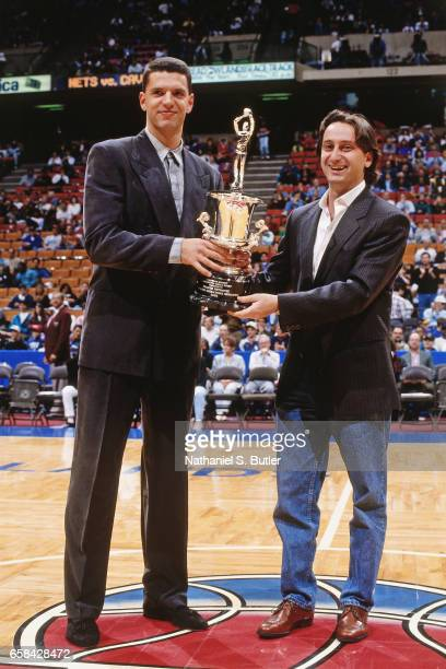 Drazen Petrovic of the New Jersey Nets is awarded the European Player of the Year Award during a game played circa 1993 at the Brendan Byrne Arena in...