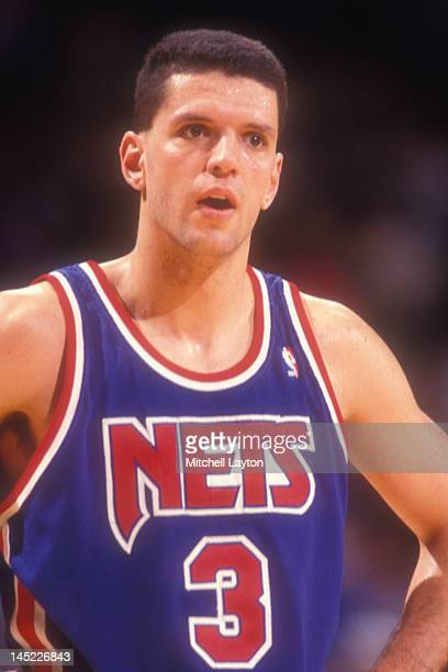 Drazen Petrovic of the New Jersey Nets looks on during a basketball game against the Washington Bullets at the Capitol Centre on March 25 1991 in...
