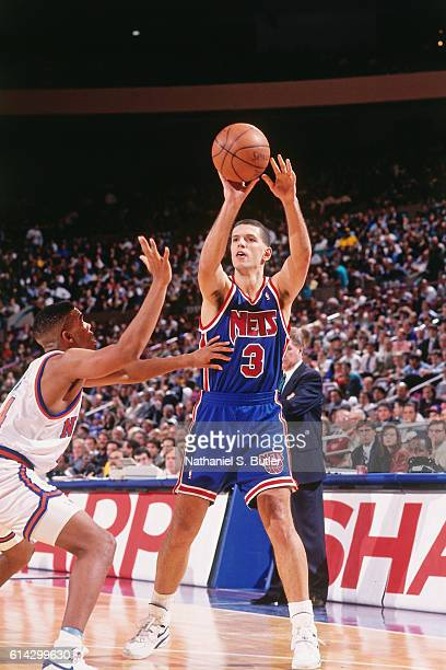 Drazen Petrovic of the New Jersey Nets passes against the New York Knicks during a game played circa 1993 at Madison Square Garden in New York New...