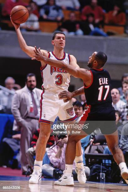 Drazen Petrovic of the New Jersey Nets passes the ball against the Portland Trail Blazers during a game played circa 1993 at the Brendan Byrne Arena...