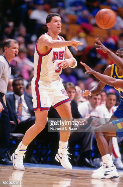 Drazen Petrovic of the New Jersey Nets passes the ball during the game against the Denver Nuggets circa 1993 at the Brendan Byrne Arena in East...