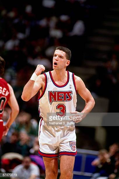 Drazen Petrovic of the New Jersey Nets pumps his fist against Bobby Hansen of the Chicago Bulls during a game in 1991 at Brendan Byrne Arena in East...