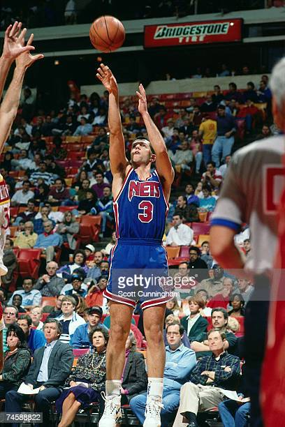 Drazen Petrovic of the New Jersey Nets shoots a jump shot against the Atlanta Hawks duiring a 1991 NBA game at the OMNI Colisieum in Atlanta Georgia...