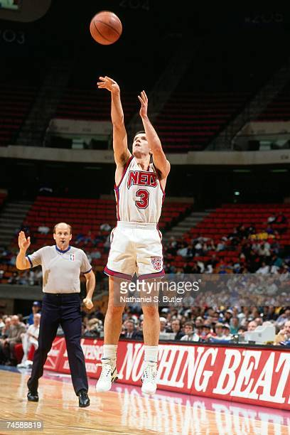 Drazen Petrovic of the New Jersey Nets shoots a jump shot during a 1991 NBA game at the Brendan Byrne Arena in East Rutherford New Jersey NOTE TO...