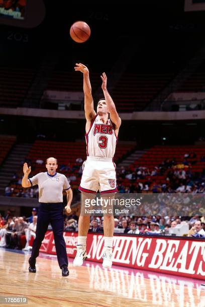 Drazen Petrovic of the New Jersey Nets shoots a jump shot during an NBA game at the Continental Airlines Arena in 1991 in East Rutherford New Jersey...