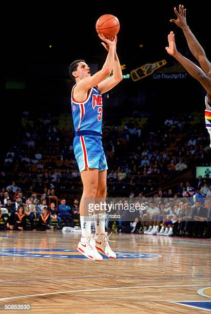Drazen Petrovic of the New Jersey Nets shoots a jumper against the Denver Nuggets during a 199091 season game at McNichols Arena in Denver Colorado...