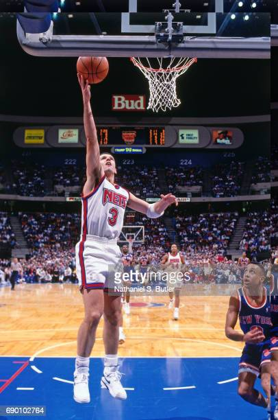 Drazen Petrovic of the New Jersey Nets shoots a lay up during the game against the New York Knicks circa 1993 at the Brendan Byrne Arena in East...