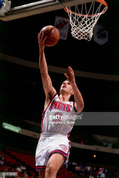 Drazen Petrovic of the New Jersey Nets shoots a layup during a game played in 1991 at the Brendan Byrne Arena in East Rutherford New Jersey NOTE TO...