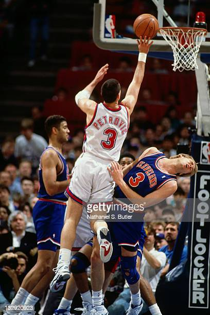 Drazen Petrovic of the New Jersey Nets shoots against Craig Ehlo of the Cleveland Cavaliers circa 1991 at the Brendan Byrne Arena in East Rutherford...