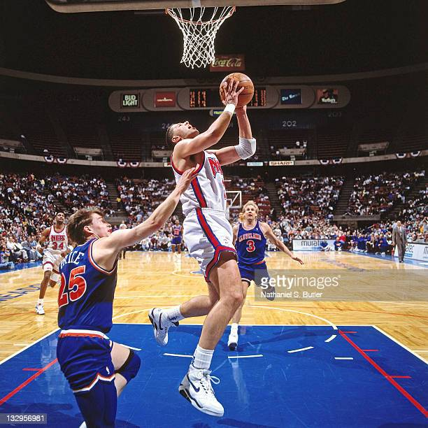 Drazen Petrovic of the New Jersey Nets shoots against Mark Price of the Cleveland Cavaliers circa 1991 at the Brendan Byrne Arena in East Rutherford...