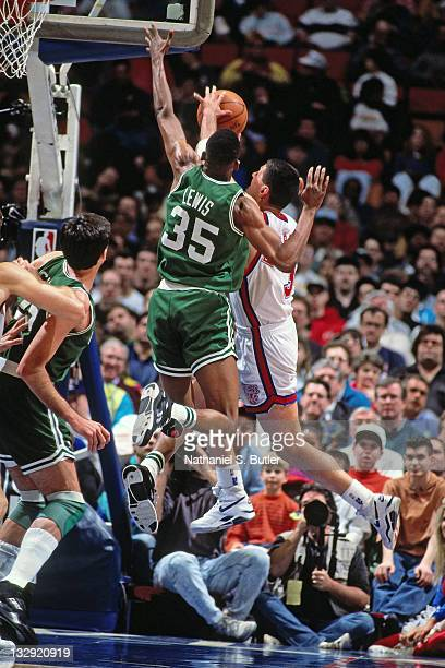 Drazen Petrovic of the New Jersey Nets shoots against Reggie Lewis of the Boston Celtics circa 1991 at the Brendan Byrne Arena in East Rutherford New...