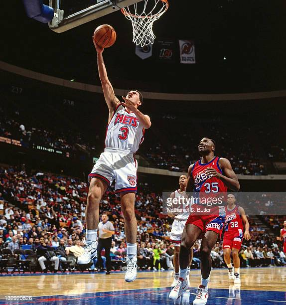 Drazen Petrovic of the New Jersey Nets shoots against the Philadelphia 76ers circa 1991 at the Brendan Byrne Arena in East Rutherford New Jersey NOTE...