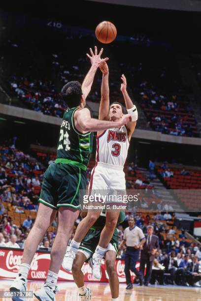 Drazen Petrovic of the New Jersey Nets shoots against the Milwaukee Bucks during a game played circa 1993 at the Brendan Byrne Arena in East...