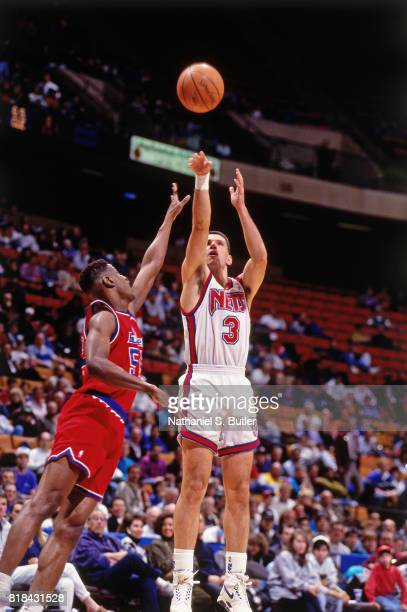 Drazen Petrovic of the New Jersey Nets shoots against the Washington Bullets at the Brendan Byrne Arena in East Rutherford NJ circa 1991 NOTE TO USER...