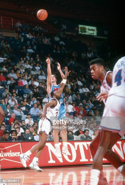 Drazen Petrovic of the New Jersey Nets shoots against the Washington Bullets during an NBA basketball game circa 1991 at the Capital Centre in...
