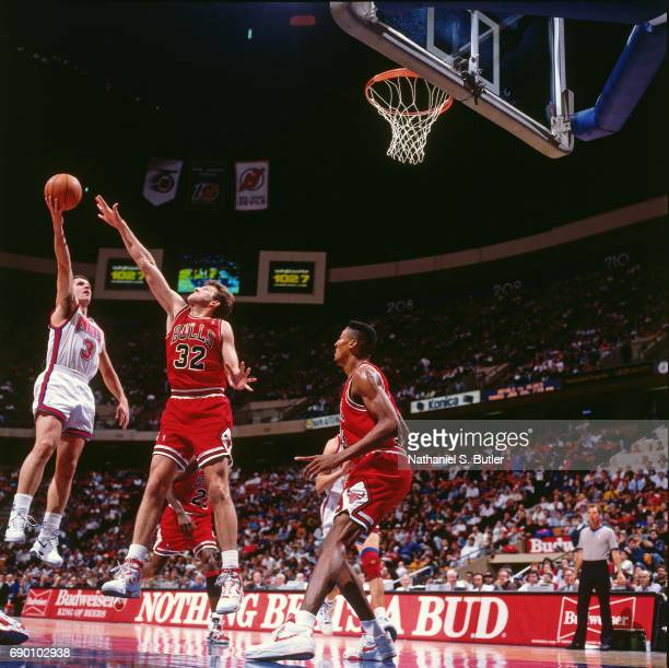 Drazen Petrovic of the New Jersey Nets shoots the ball during the game against the Chicago Bulls circa 1993 at the Brendan Byrne Arena in East...