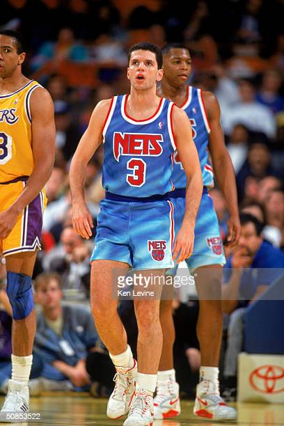 Drazen Petrovic of the New Jersey Nets stands on the court during a 199091 season game against the Los Angeles Lakers at the Great Western Forum in...