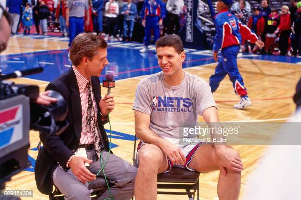 Drazen Petrovic of the New Jersey Nets talks to the media against the Detroit Pistons during a game played circa 1993 at the Brendan Byrne Arena in...