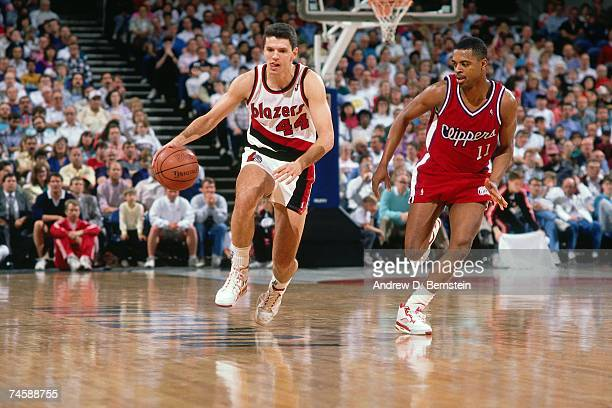 Drazen Petrovic of the Portland Trail Blazers dribbles upcourt against the Los Angeles Clippers during a 1990 NBA game at the Rose Garden in Portland...
