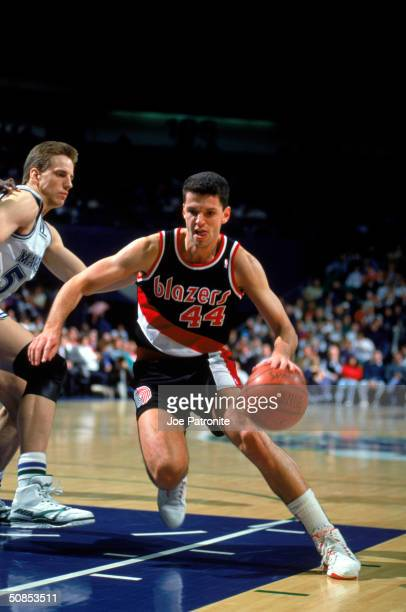 Drazen Petrovic of the Portland Trail Blazers drives to the hoop during the game against the Dallas Mavericks at the Reunion Arena during the 1991...