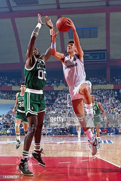 Drazen Petrovic of the Yugoslavian National Team shoots against Robert Parish of the Boston Celtics during the 1988 McDonald's Open on October 21...