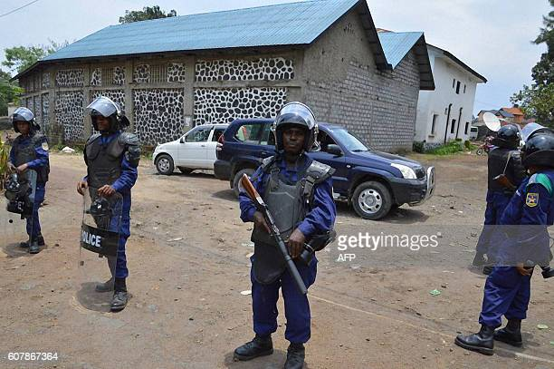 DRCongo Police forces stand guard during a demonstration in Goma on September 19 2016 At least 17 people mostly civilians were killed on September 19...