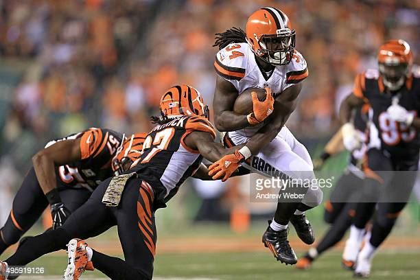 Dre Kirkpatrick of the Cincinnati Bengals attempts to tackle Isaiah Crowell of the Cleveland Browns during the second quarter at Paul Brown Stadium...