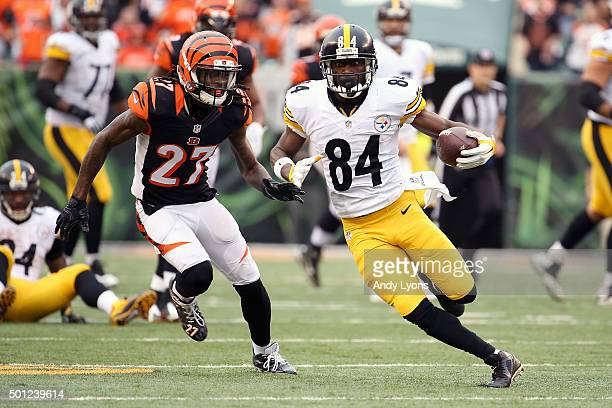 Dre Kirkpatrick of the Cincinnati Bengals chases after Antonio Brown of the Pittsburgh Steelers during the third quarter at Paul Brown Stadium on...