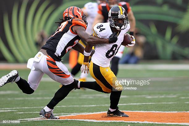 Dre Kirkpatrick of the Cincinnati Bengals tackles Antonio Brown of the Pittsburgh Steelers during the first quarter at Paul Brown Stadium on December...
