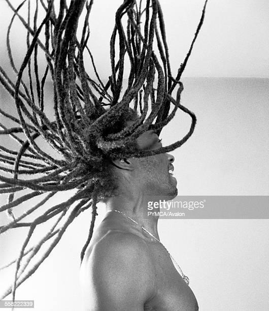 A dreadlocked man flinging his hair backward Ibiza 2004