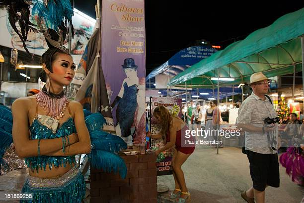 Dream a ladyboy dancer at the Chiang Mai Cabaret show stands in the night market recruiting tourists before a performance September 8 2012 in Chiang...