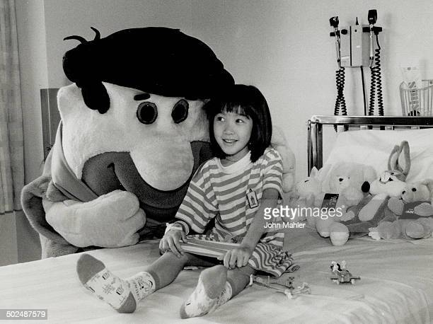 Dream come true Elizabeth Lue 6 beams yesterday at special visitor Fred Flintstone of Canada's Wonderland in her room at the Hospital for Sick...