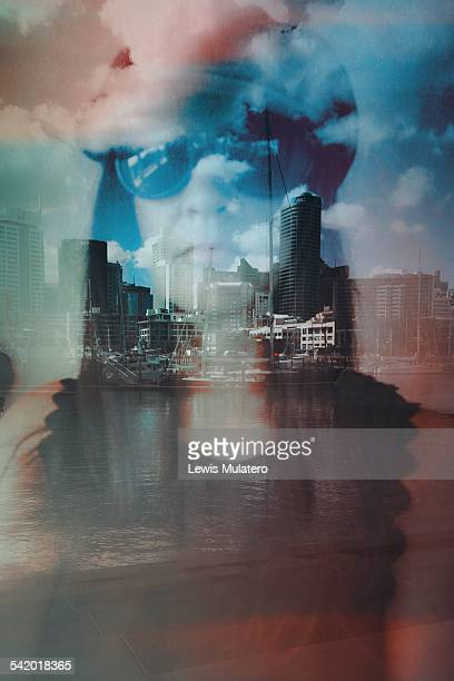 I dream of sailing away Self portrait double exposure Female face wearing sunglasses double exposed with waterfront cityscape yachts sail boats and...