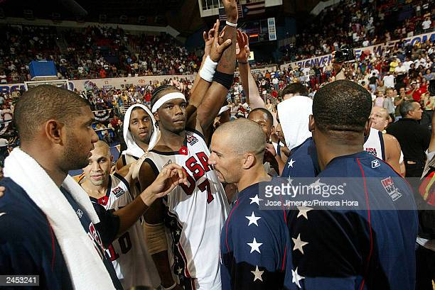 Dream Team players celebrate their gold medal victory after defeating Argentina 106-73 during the gold Medal game of the Athens Olympic Qualifying...