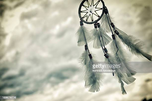 Dreamcatcher under an approaching thunderstorm