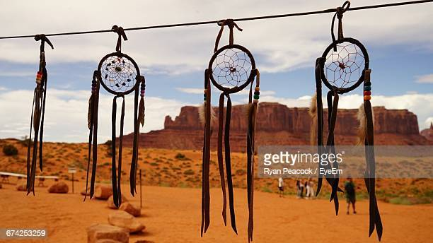 Dreamcatchers Hanging On Rope At Desert Against Sky