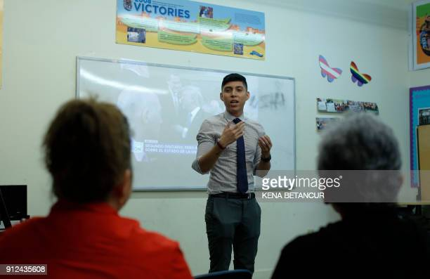Dreamer Anthony Alarcon speaks to guest as they attend a meeting at a community center to watch broadcast of US President delivering his first State...