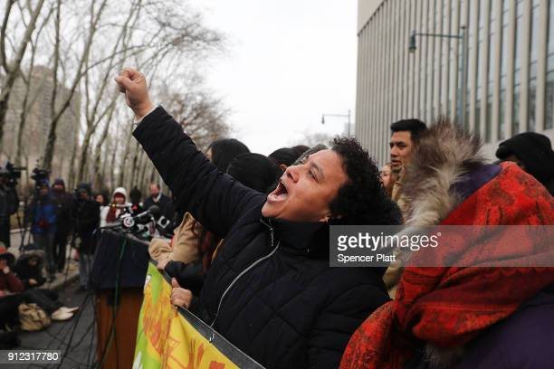 Dreamers and other recent immigrants to the United States cheer as they participate in a news conference with New York Attorney General Eric T...