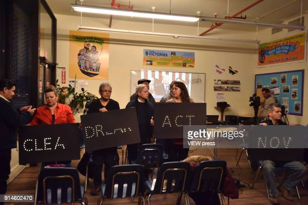 Dreamers DACA recipients and their supporters turn their backs on US President Donald Trump on screen during the State of Union speech at the...