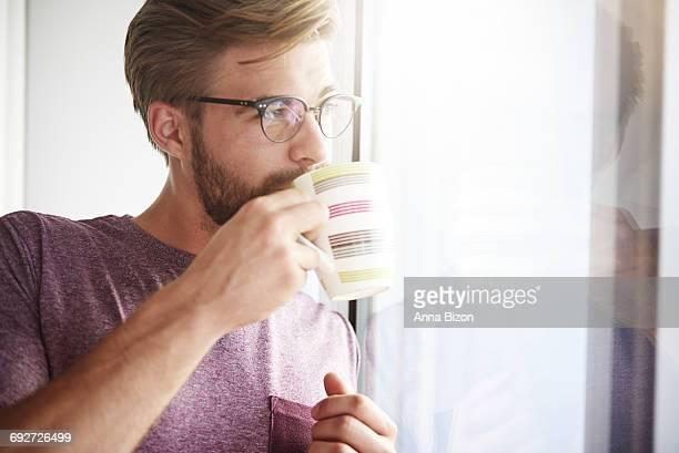 Dreaming man drinking fresh coffee. Debica, Poland.