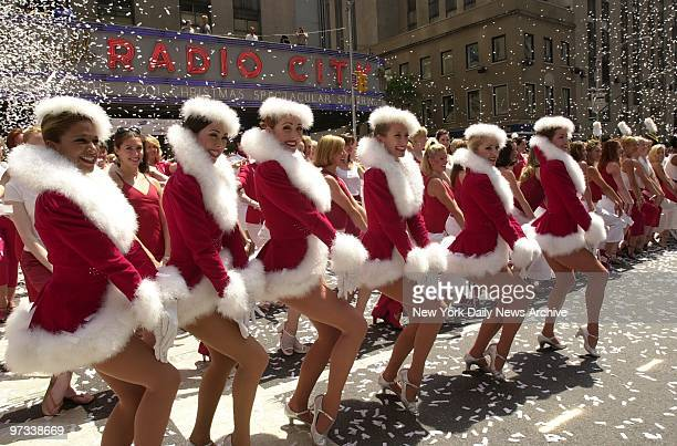 Dreaming of a white Christmas Dream onThose are just paper flakes landing on the Rockettes as they step out in front of Radio City Music Hall on a...