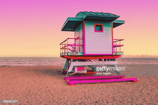 dreamlike picture of colorful lifeguard cabin in the miami beach at sunset. - miami stock pictures, royalty-free photos & images