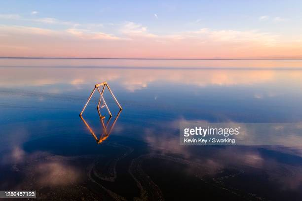 dreamy bombay beach at the salton sea prior to sunset - installation art stock pictures, royalty-free photos & images