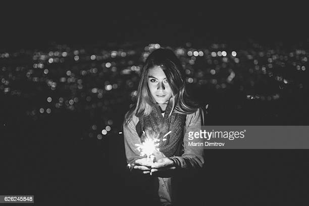 dreamy girl celebrating new year on the rooftop - desiderio foto e immagini stock