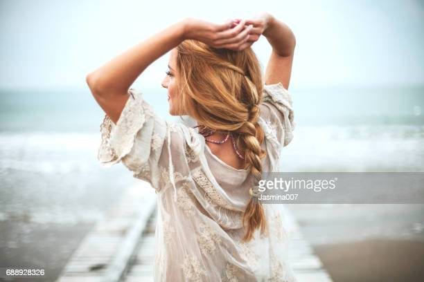 dreamy girl  on beach - dress stock pictures, royalty-free photos & images