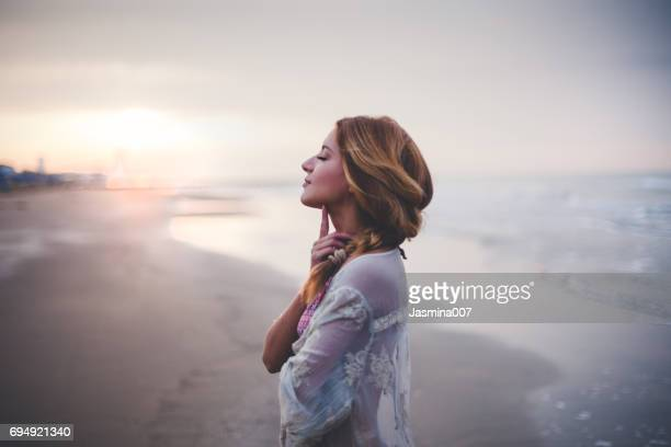 dreamy girl  on beach - tranquility stock pictures, royalty-free photos & images