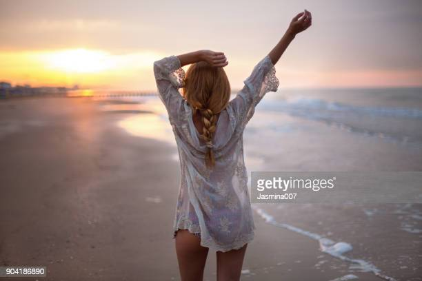 dreamy girl on beach - light natural phenomenon stock pictures, royalty-free photos & images