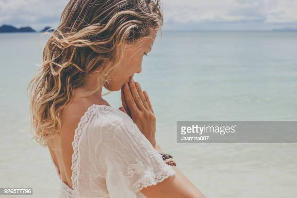 dreamy girl on beach - spirituality stock pictures, royalty-free photos & images