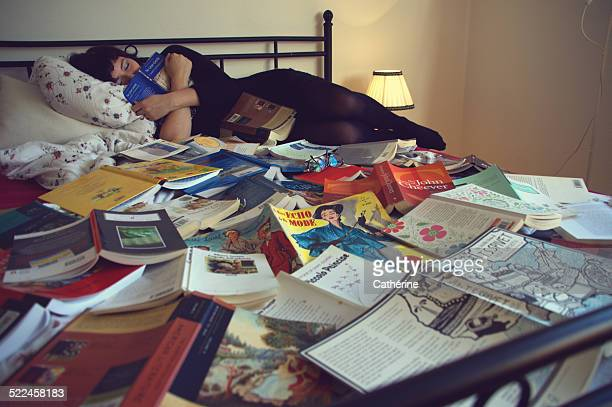 Dreamy girl sleeping on books/literature