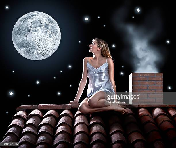 Dreamy girl under the moon